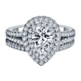 14K white gold halo engagement ring set with 1 brilliant cut pear shaped diamond weighing approximately 7/8 ct. tw. and 95 round brilliant cut diamonds weighing approximately 5/8 ct. tw.